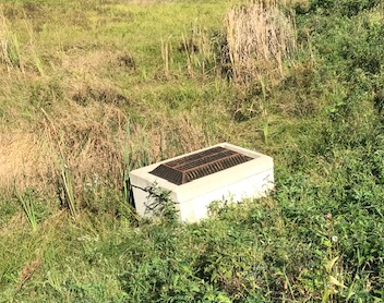 Boxed culvert encased in concrete was present